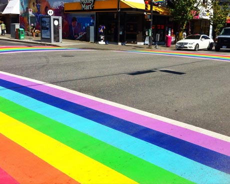 People walking on the Rainbow Crosswalk